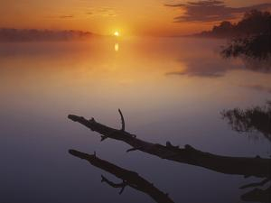 Near St Charles at Sunrise on the Mississippi River, Missouri, USA by Charles Gurche