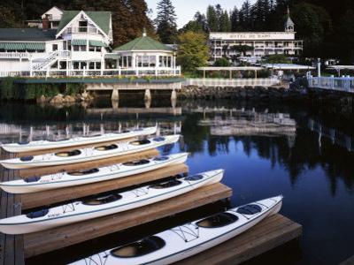 Sea Kayaks at Roche Harbor, San Juan Island, Washington, USA by Charles Gurche