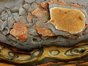 Detail of Eroded Rocks Swirled with Colors and Patterns by Charles Kogod