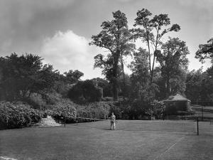 Man Plays Tennis at the Country Home of the Lowndes Family by Charles Martin