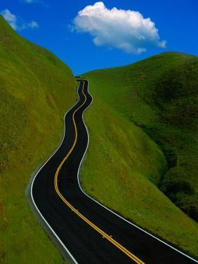 Highway Winding Through Countryside by Charles O'Rear