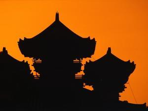 Silhouette of Japanese Temple by Charles O'Rear