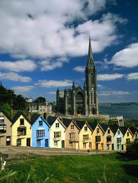 St. Coleman's Cathedral of Cobh Behind Colorful Row Houses by Charles O'Rear