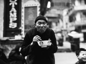 Chinese Man Using Chopsticks To Eat From Bowl, Portrait, Hong Kong by Charles Phelps Cushing