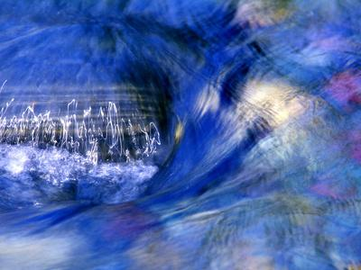 Abstract of Water Flowing Over Rock in Sunlight, Alpharetta, Georgia, USA