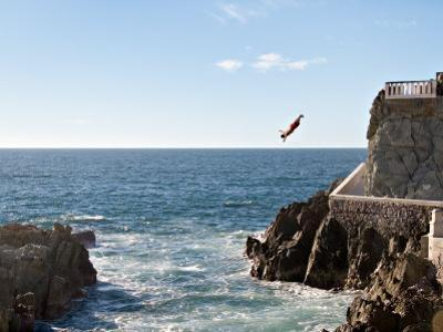 Cliff Diver Diving From El Mirador at Paseo Claussen, Mazatlan, Mexico by Charles Sleicher