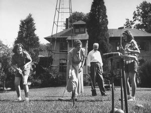Charles V. Broadley Playing Croquet with His Family after Wife's Recovery from Blindness