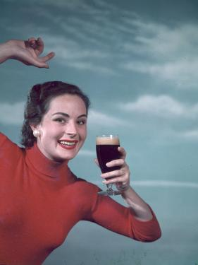 Girl and Guinness 1950s by Charles Woof