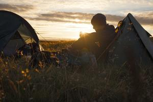 A camper sits in the evening sun, Picws Du, Black Mountain, Brecon Beacons National Park, Wales, Un by Charlie Harding