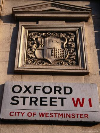 Coat of Arms and Street Sign on Wall, Oxford St, London, United Kingdom by Charlotte Hindle