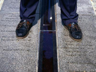 Feet Standing on the East/West Meridian Line at the Royal Observatory, Greenwich, London, Uk by Charlotte Hindle
