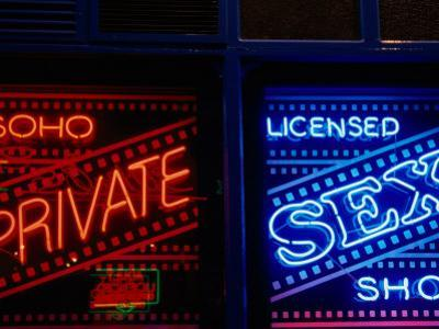 Neon Signs in Windows of Soho Sex Shop, London, United Kingdom by Charlotte Hindle