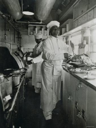 Chef at Work in the Galley of a Baltimore and Ohio Train