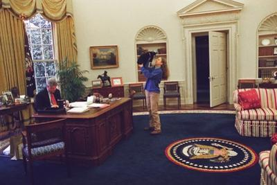 Chelsea Clinton Playing with Socks the Cat in the Oval Office