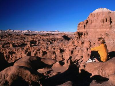 Hiker at Viewpoint Overlooking Goblin Valley State Park, Utah, USA by Cheyenne Rouse