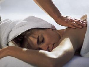 Woman Getting Massage at Health Spa by Cheyenne Rouse