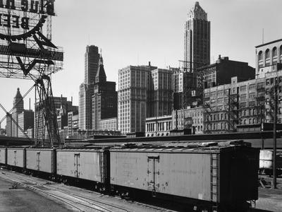 https://imgc.allpostersimages.com/img/posters/chicago-skyline-from-water-street_u-L-Q10PFKV0.jpg?p=0
