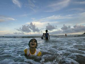 Child as She Plays in the Waves at a Beach in Port Blair, India