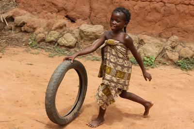 https://imgc.allpostersimages.com/img/posters/child-playing-with-a-tyre-tori-benin_u-L-Q1GYN030.jpg?artPerspective=n