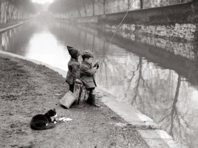 Children Fishing in River