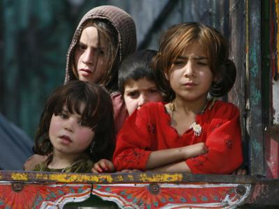 Children from Swat Arrive on a Truck at a Refugee Camp in Mardan, Northwest Pakistan