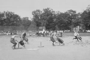 Children In Wheel Barrow Race