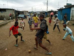 Children Play Soccer in an Impoverished Street in Lagos, Nigeria