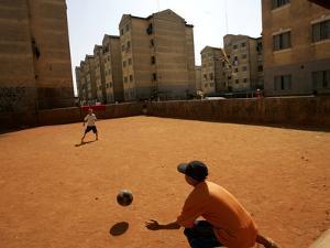 Children Play Soccer in Novo Mundo Slum, in Sao Paulo, Brazil