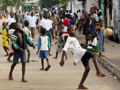 Children Play Soccer on a Monrovian Street