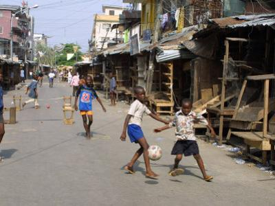 Children Play Soccer on One of the Streets of the Business District of Lagos