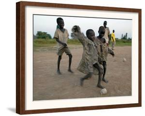 Children Play with Homemade Soccer Balls Made from Discarded Medical Gloves