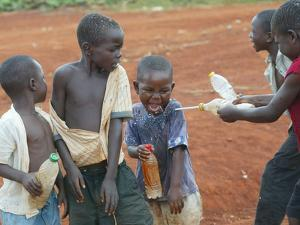 Children Play with Water Near a Zimbabwean Movement for Democratic Change (MDC) Election Rally