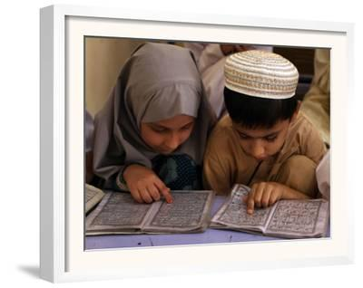 Children Read Together from Muslim's Holy Quran in Karachi, Pakistan