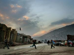 Children Run Across the Street as Spring Temperatures Return to Kabul