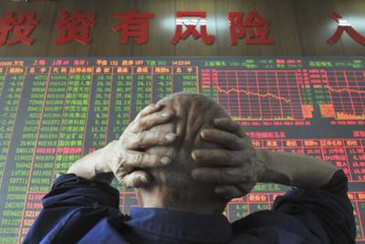 An Investor Looks at an Electronic Board Showing Stock Information, Shanxi Province