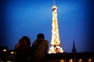 A Couple Watch the Eiffel Toer Glitter at Night in Paris, France by Chris Bickford