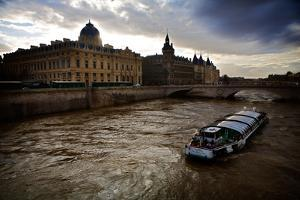 A Ferry in the Seine River During the Day in Paris, France by Chris Bickford