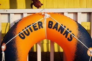 A Flotation Toy Hangs Outside a Store in Hatteras Village in North Carolina by Chris Bickford