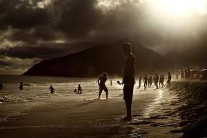 A Man Stands on Ipanema Beach Looking Out to Sea by Chris Bickford