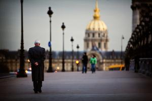 A Man Walks Down the Street Towards Les Invalides in Paris, France by Chris Bickford