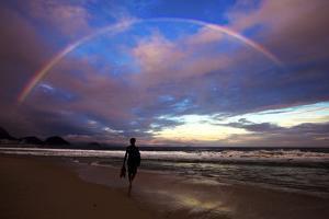 A Rainbow over Copacabana Beach in Rio De Janeiro by Chris Bickford