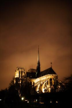 A Rear View of the Notre Dame Illuminated at Night in Paris, France by Chris Bickford