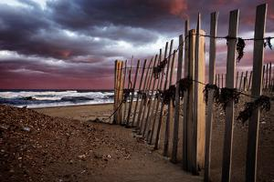 A Wooden Fence on a Sandy Beach on the Outer Banks of North Carolina by Chris Bickford