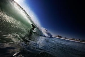 A Young Man Surfs Through the Barrel of a Wave on the Outer Banks of North Carolina by Chris Bickford