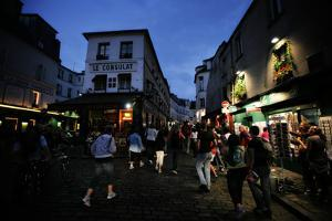 Crowds Fill the Streets of Paris at Night by Chris Bickford