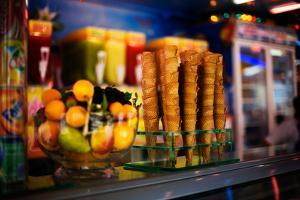 Ice Cream Cones and Fruit in a Store in Paris by Chris Bickford