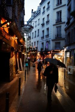 On a Rainy Day, Pedestrians Navigate the Streets of Paris by Chris Bickford