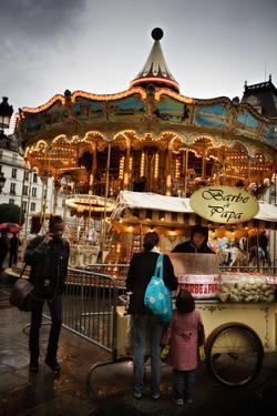 Pedestrians around a Carousel During a Rainy Day in Paris, France by Chris Bickford