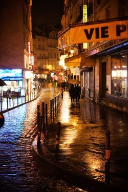 People Strolling Through the Rainy Streets at Night in Paris, France by Chris Bickford