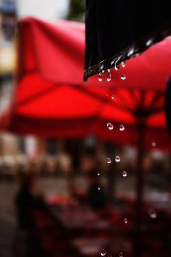 Rain Droplets Outside a Cafe in Paris, France by Chris Bickford